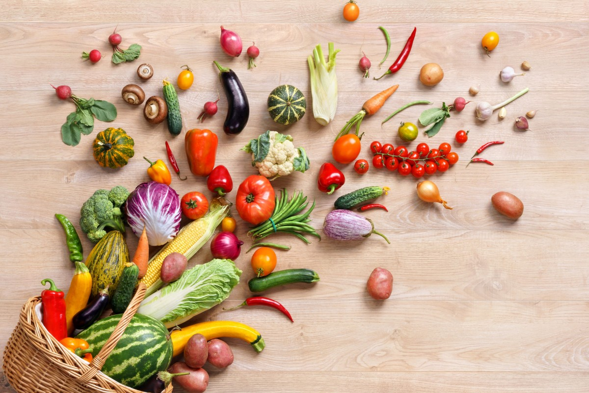 52849018 - healthy food background. studio photography of different fruits and vegetables on wooden table