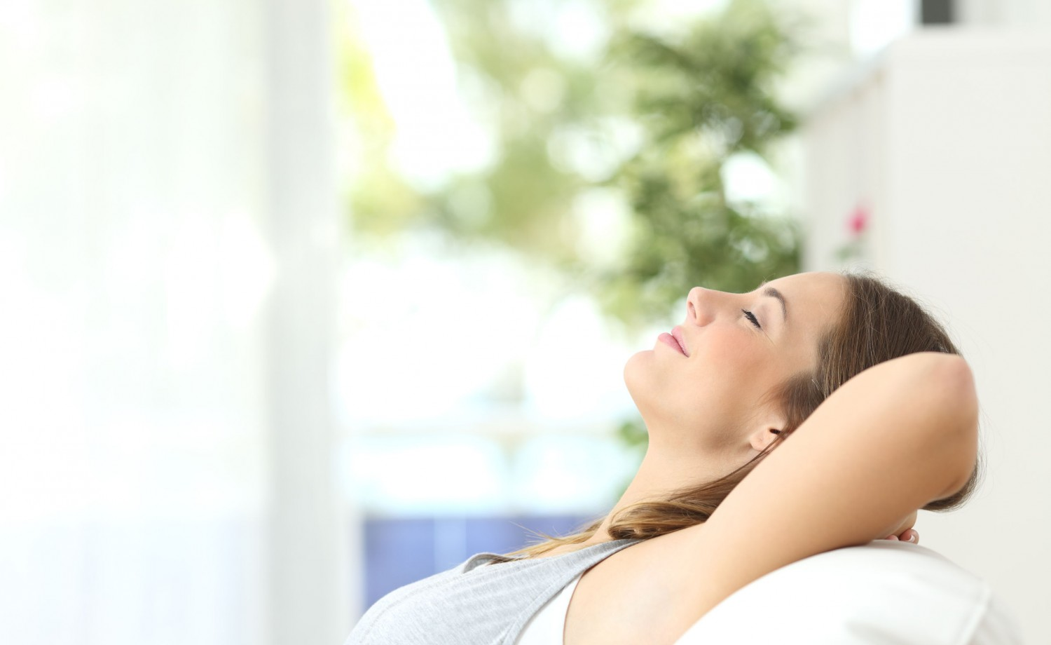 50532401 - profile of a beautiful woman relaxing lying on a couch at home
