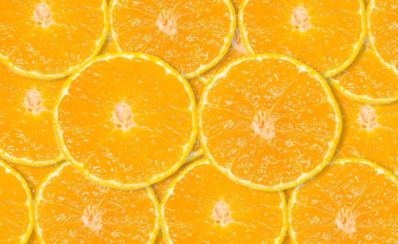 slice of fresh orange background