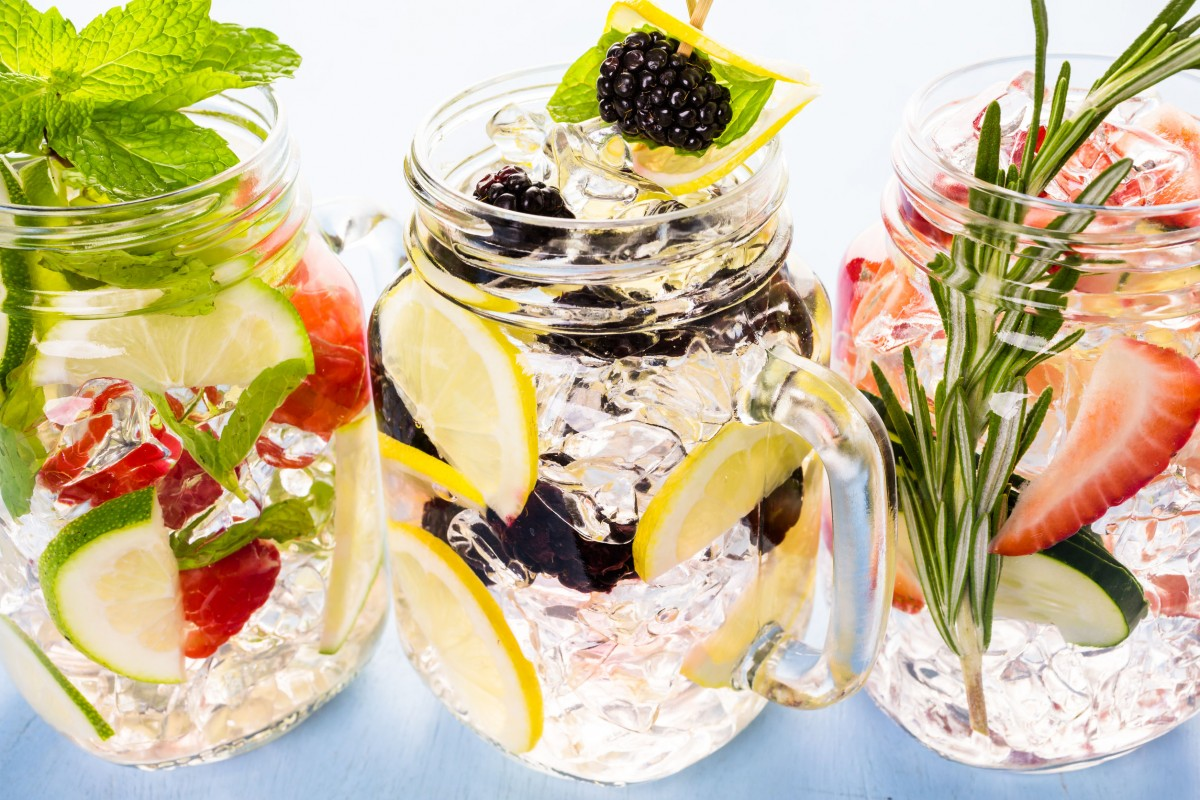 40140580 - fresh infused water made with organic ccitruses and berries.